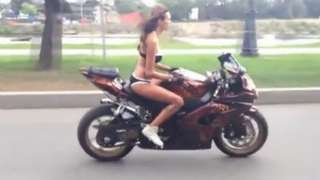 Daring Bikini Biker On Highway