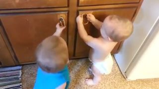 Twin Toddlers Vs. Rubber Bands